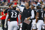 Cincinnati head coach Luke Fickell, right, congratulates running back Gerrid Doaks (23) after his touchdown during the second half of an NCAA college football game against Tulsa, Saturday, Oct. 19, 2019, in Cincinnati. (AP Photo/John Minchillo)
