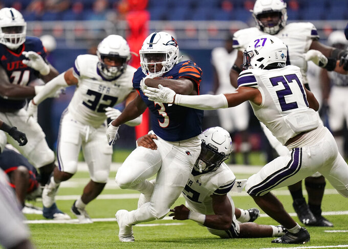 UTSA running back Sincere McCormick (3) runs past Stephen F. Austin safety JaTerious Evans (27) during the first half of an NCAA college football game, Saturday, Sept. 19, 2020, in San Antonio. (AP Photo/Eric Gay)