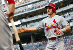 St. Louis Cardinals' Harrison Bader is greeted after scoring on a single by Carson Kelly off Minnesota Twins pitcher Jose Berrios during the third inning of a baseball game Tuesday, May 15, 2018, in Minneapolis. (AP Photo/Jim Mone)