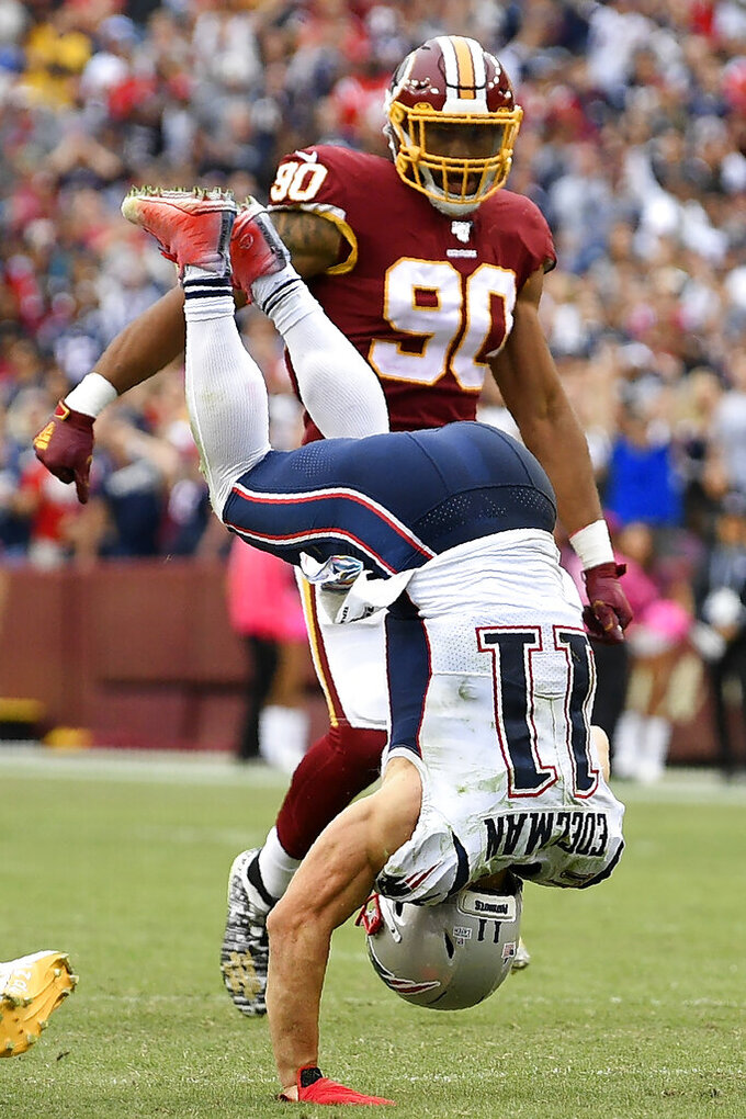 New England Patriots wide receiver Julian Edelman (11) is hit by Washington Redskins strong safety Landon Collins (20) during the second half of an NFL football game, Sunday, Oct. 6, 2019, in Washington. (AP Photo/Nick Wass)