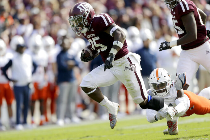 Spiller runs for 217 yards, 3 TDs as Aggies beat UTSA 45-14