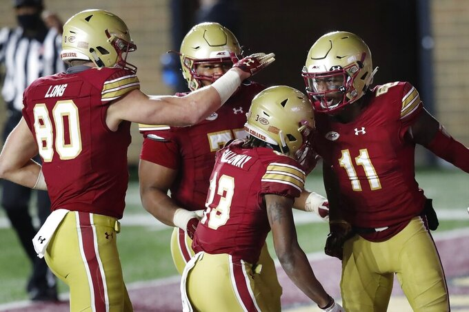 Boston College wide receiver Jehlani Galloway (13) celebrates his touchdown with teammates during the second half of an NCAA college football game against Louisville, Saturday, Nov. 28, 2020, in Boston. (AP Photo/Michael Dwyer)