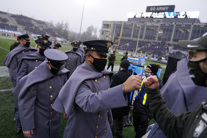 Army cadets leave the field after marching before an NCAA college football game against Navy on Saturday, Dec. 12, 2020, in West Point, N.Y. (AP Photo/Andrew Harnik)