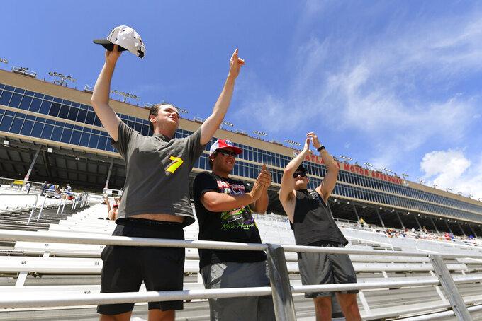 Fans cheer driver introductions before a NASCAR Xfinity Series auto race Saturday, July 10, 2021, in Hampton, Ga. (AP Photo/John Amis)