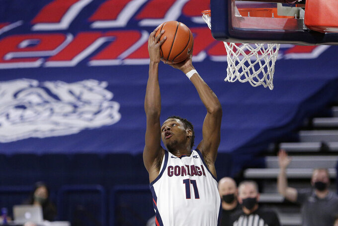Gonzaga guard Joel Ayayi grabs a rebound during the second half of an NCAA college basketball game against Santa Clara in Spokane, Wash., Thursday, Feb. 25, 2021. (AP Photo/Young Kwak)