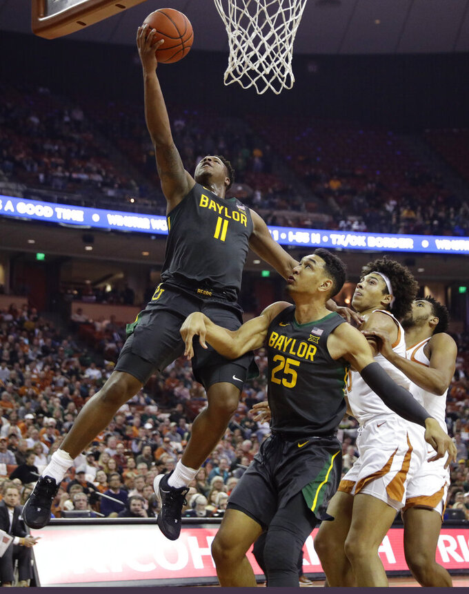Baylor guard Mark Vital (11) scores against Texas during the first half of an NCAA college basketball game, Monday, Feb. 10, 2020, in Austin, Texas. (AP Photo/Eric Gay)
