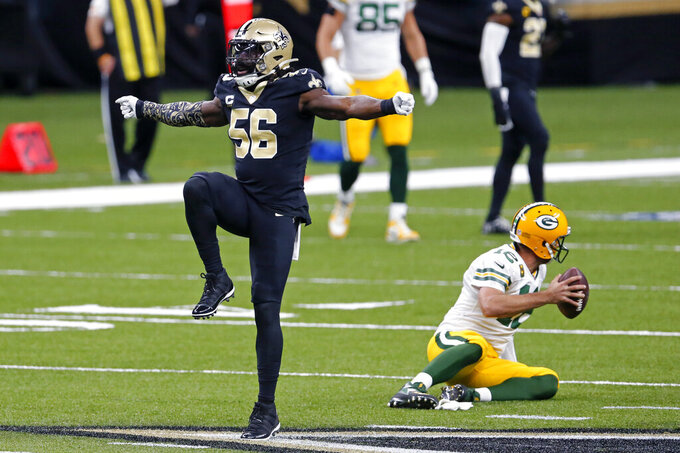 New Orleans Saints outside linebacker Demario Davis (56) celebrates a sack of Green Bay Packers quarterback Aaron Rodgers (12) in the first half of an NFL football game in New Orleans, Sunday, Sept. 27, 2020. (AP Photo/Brett Duke)