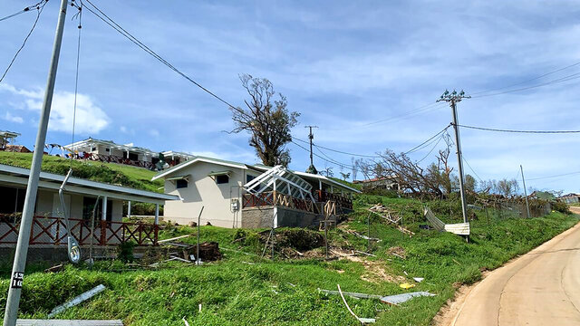 In this April 8, 2020, photo supplied by World Vision, a house is damaged from Cyclone Harold on the island of Santo in Vanuatu. New Zealand announced Wednesday, April 8, 2020 it would help Vanuatu rebuild from the cyclone with aid of up to 500,000 New Zealand dollars ($300,000). Foreign Minister Winston Peters said Cyclone Harold had destroyed homes, infrastructure and crops. (World Vision via AP)