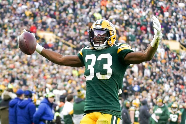 Green Bay Packers' Aaron Jones reacts after his first down run during the second half of an NFL football game against the Washington Redskins Sunday, Dec. 8, 2019, in Green Bay, Wis. (AP Photo/Morry Gash)