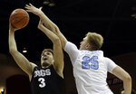 Gonzaga forward Filip Petrusev (3) shoots as San Diego forward Yauhen Massalski (25) defends during the first half of an NCAA college basketball game Saturday, Feb. 16, 2019, in San Diego. (AP Photo/Gregory Bull)