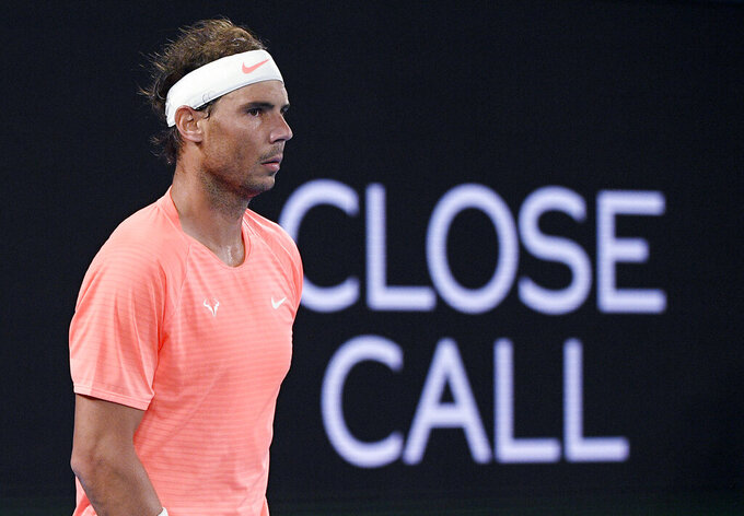 Spain's Rafael Nadal waits for a serve from Britain's Cameron Norrie during their third round match a the Australian Open tennis championships in Melbourne, Australia, Saturday, Feb. 13, 2021. (AP Photo/Andy Brownbill)