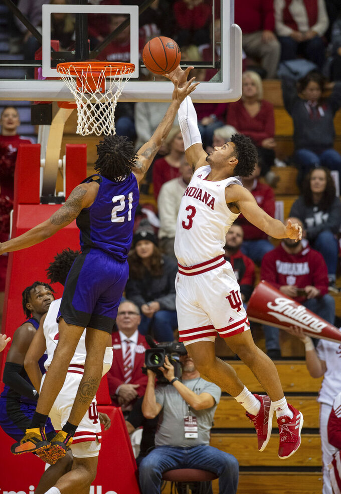 Indiana's Justin Smith (3) blocks the shot of North Alabama's Emanuel Littles (21) during the first half of an NCAA college basketball game, Tuesday, Nov. 12, 2019, in Bloomington, Ind. (AP Photo/Doug McSchooler)