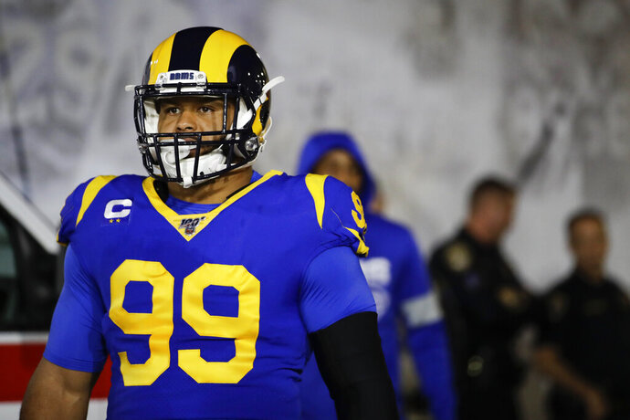 In this Dec. 8, 2019, photo, Los Angeles Rams defensive tackle Aaron Donald waits to run onto the field for an NFL football game against the Seattle Seahawks in Los Angeles. Donald is not thrilled about the prospect of playing football without fans. The Rams' superstar defensive lineman doesn't see how the NFL could play a season in front of empty seats, saying it