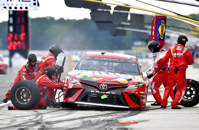 Kyle Busch makes a pit stop during a NASCAR Cup Series auto race, Sunday, July 28, 2019, in Long Pond, Pa. (AP Photo/Derik Hamilton)