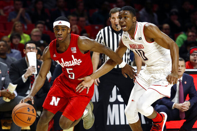 FILE - In this Wednesday, Jan. 2, 2019, file photo, Nebraska guard Glynn Watson Jr., left, drives past Maryland guard Serrel Smith Jr. in the first half of an NCAA college basketball game, in College Park, Md. Watson is the only remaining member of Nebraska's five-man 2015 recruiting class who is still on the roster. (AP Photo/Patrick Semansky, File)