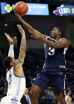 Butler guard Kamar Baldwin, right, drives to the basket against DePaul guard Devin Gage during the first half of an NCAA college basketball game Wednesday, Jan. 16, 2019, in Chicago. (AP Photo/Nam Y. Huh)