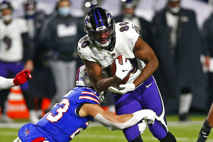 Buffalo Bills' Micah Hyde (23) tackles Baltimore Ravens' Miles Boykin (80) during the first half of an NFL divisional round football game Saturday, Jan. 16, 2021, in Orchard Park, N.Y. (AP Photo/John Munson)