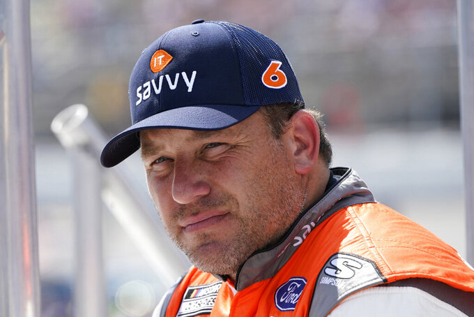 Ryan Newman talks with other drivers before driver introductions at the NASCAR Cup Series auto race at Michigan International Speedway, Sunday, Aug. 22, 2021, in Brooklyn, Mich. (AP Photo/Carlos Osorio)