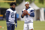 FILE - In this July 26, 2018, file photo, Dallas Cowboys running back Ezekiel Elliott (21) and quarterback Dak Prescott (4) run plays during Dallas Cowboys' NFL training camp, in Oxnard, Calif. Prescott has his backfield mate back now that Ezekiel Elliott's holdout is over. (AP Photo/Gus Ruelas, File)