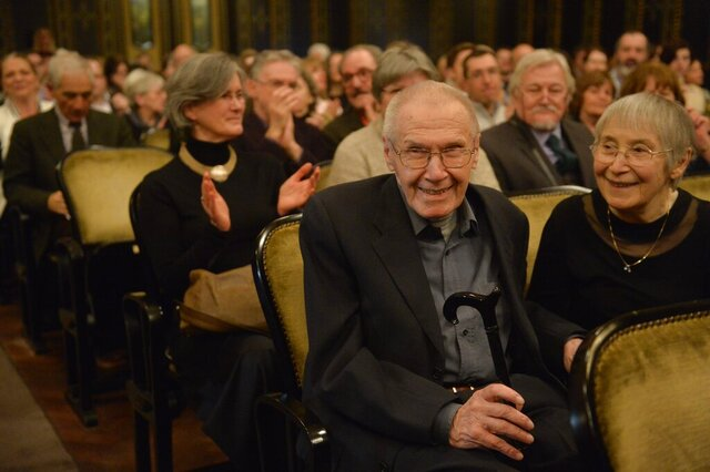 FILE - In this Feb. 19, 2016, file photo, Hungarian conductor and pianist Gyorgy Kurtag, second right, is applauded next to his wife Marta Kurtag, right, on the occasion of his 90th birthday during his anniversary concert at the Liszt Academy of Music in Budapest, Hungary. The American premiere of Kurtag's