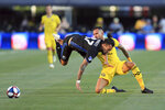 Montreal Impact's Maximiliano Urruti, left, is upended by Columbus Crew's Artur as they battle for the ball during the first half of an MLS soccer match, Saturday, July 20, 2019, in Columbus, Ohio. (AP Photo/Aaron Doster)