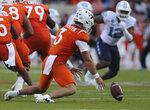 Virginia Tech quarterback Braxton Burmeister (3) recovers a fumble from center Brock Hoffman during the first of the team's NCAA college football game against North Carolina on Friday, Sept. 3, 2021, in Blacksburg, Va. (Matt Gentry/The Roanoke Times via AP)
