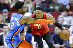 Houston Rockets guard Russell Westbrook (0) dribbles as Oklahoma City Thunder guard Shai Gilgeous-Alexander defends during the first half of an NBA basketball game, Monday, Jan. 20, 2020, in Houston. (AP Photo/Eric Christian Smith)