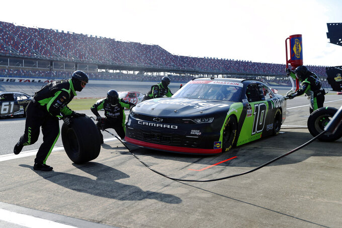 Ross Chastain (10) gets service in the pits during a NASCAR Xfinity auto race at Talladega Superspeedway in Talladega Ala., Saturday, June 20, 2020. (AP Photo/John Bazemore)