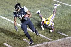 Vanderbilt running back Jamauri Wakefield (32) gets past LSU safety Cameron Lewis (31) in the first half of an NCAA college football game Saturday, Oct. 3, 2020, in Nashville, Tenn. (AP Photo/Mark Humphrey)