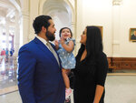 Donovon Rodriguez, chief of staff for Texas state Rep. Ray Lopez, poses for a photo at the Texas Capitol with his wife, Jenny Tavarez, and daughter, Evelyn Belle Rodriguez, for whom he is the sole provider, Monday, July 26, 2021, in Austin, Texas. Rodriguez could lose his job by Sept. 1, if legislative budget funding is not restored. (AP Photo/Acacia Coronado)