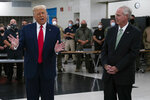 FILE - In this Sept. 1, 2020 file photo, President Donald Trump speaks in Kenosha, Wis., as Sen. Ron Johnson, R-Wis., right, listens. Sen. Johnson said Monday, Sept. 14, 2020, that President Donald Trump deserves to win more than one Nobel Peace Prize for his