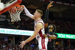 Wisconsin's Micah Potter, left, dunks past Rutgers' Myles Johnson (15) during the second half of an NCAA college basketball game Sunday, Feb. 23, 2020, in Madison, Wis. (AP Photo/Andy Manis)