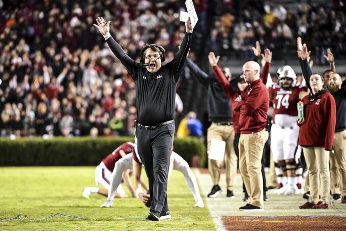 South Carolina head coach Will Muschamp, center, calls for a touchdown against Vanderbilt during the first half of an NCAA college football game Saturday, Nov. 2, 2019, in Columbia, S.C. (AP Photo/Sean Rayford)