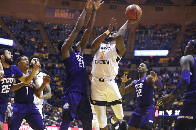West Virginia upsets TCU 104-96 in 3OT thriller