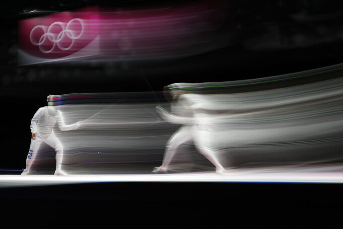 Anita Blaze of France, right, and Arianna Errigo of Italy compete in the women's individual Foil semifinal competition at the 2020 Summer Olympics, Thursday, July 29, 2021, in Chiba, Japan. (AP Photo/Hassan Ammar)