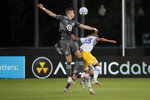 Minnesota United midfielder Jan Gregus, left, and San Jose Earthquakes midfielder Judson vie for the ball during the first half of an MLS soccer match, Saturday, Aug. 1, 2020, in Kissimmee, Fla. (AP Photo/John Raoux)
