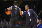 Tulsa coach Frank Haith celebrates with guard Elijah Joiner (3) after Tulsa defeated Vanderbilt 67-58 in an NCAA college basketball game Saturday, Nov. 30, 2019, in Nashville, Tenn. (AP Photo/Mark Humphrey)