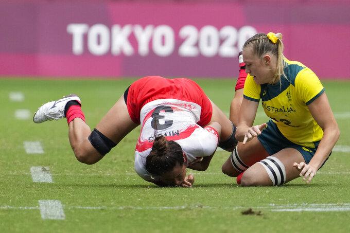 Australia's Maddison Levi, right, collides with Japan's Miyu Shirako in their women's rugby sevens match at the 2020 Summer Olympics, Thursday, July 29, 2021 in Tokyo, Japan. (AP Photo/Shuji Kajiyama) Japan's Miyu Shirako