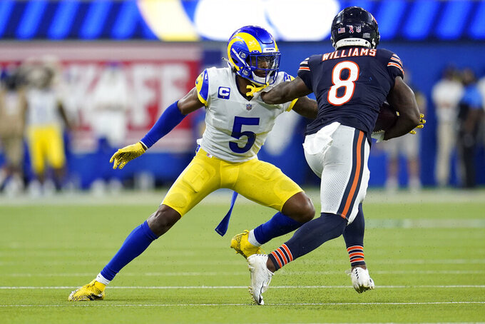 Los Angeles Rams cornerback Jalen Ramsey, left, defends against Chicago Bears running back Damien Williams during the second half of an NFL football game Sunday, Sept. 12, 2021, in Inglewood, Calif. (AP Photo/Marcio Jose Sanchez)