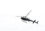 A Tulsa police helicopter circles the area where two police officers were shot near 21st Street and Memorial Drive in Tulsa, Okla., on Monday, June 29, 2020. (Matt Barnard/Tulsa World via AP)