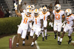 Tennessee's Henry To'o To'o (11), Trevon Flowers (1), Deandre Johnson (13) and Kenneth George Jr. (5) celebrate an interception return for a touchdown against South Carolina during the first half of an NCAA college football game Saturday, Sept. 26, 2020, in Columbia, S.C. (AP Photo/Sean Rayford)