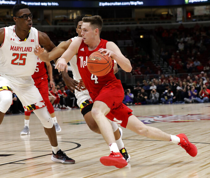 Nebraska's Johnny Trueblood (4) drives against the Maryland defense during the first half of an NCAA college basketball game in the second round of the Big Ten Conference tournament, Thursday, March 14, 2019, in Chicago. (AP Photo/Nam Y. Huh)