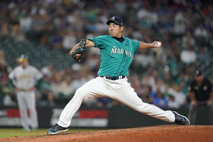 Seattle Mariners starting pitcher Yusei Kikuchi throws to an Oakland Athletics batter during the sixth inning of a baseball game Friday, July 23, 2021, in Seattle. (AP Photo/Ted S. Warren)