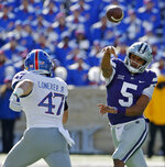 Kansas State quarterback Alex Delton (5) passes over Kansas linebacker Keith Loneker Jr. (47) during the first half of an NCAA college football game Saturday, Nov. 10, 2018, in Manhattan, Kan. (AP Photo/Charlie Riedel)