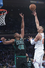 New York Knicks center Enes Kanter (00) goes to the basket against Boston Celtics forward Al Horford (42) during the first half of an NBA basketball game, Saturday, Oct. 20, 2018, at Madison Square Garden in New York. (AP Photo/Mary Altaffer)
