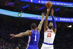 New York Knicks' Marcus Morris Sr., right, shoots the ball against Philadelphia 76ers' Mike Scott, left, during the first half of an NBA basketball game, Wednesday, Nov. 20, 2019, in Philadelphia. (AP Photo/Chris Szagola)