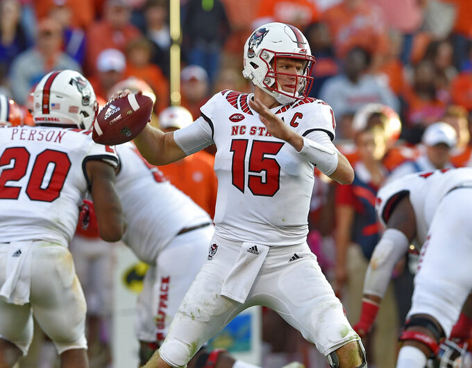 North Carolina State quarterback Ryan Finley drops back to pass during the second half of an NCAA college football game against Clemson, Saturday, Oct. 20, 2018, in Clemson, S.C. (AP Photo/Richard Shiro)