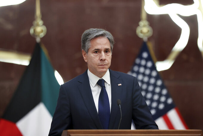 U.S. Secretary of State Antony Blinken participates in a news conference with Kuwaiti Foreign Minister Sheikh Ahmad Nasser Al-Mohammad Al-Sabah at the Ministry of Foreign Affairs in Kuwait City, Kuwait, Thursday,  July 29, 2021. (Jonathan Ernst/Pool via AP)