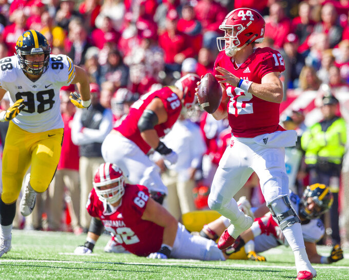 Indiana quarterback Peyton Ramsey (12) scrambles in the backfield as he looks for an open receiver during the first half of an NCAA college football game against Iowa, Saturday, Oct. 13, 2018, in Bloomington, Ind. (AP Photo/Doug McSchooler)