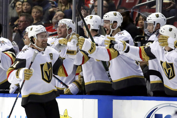 Vegas Golden Knights right wing Mark Stone (61) is congratulated after scoring a goal during the second period of an NHL hockey game against the Florida Panthers, Thursday, Feb. 6, 2020, in Sunrise, Fla. (AP Photo/Lynne Sladky)
